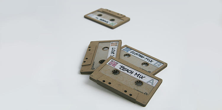 <p>This project resurrects the mixtape as a personal, customizable affect, though here, the form is separate from the function. The cardboard shells recreate the shape of cassette tapes with the tape.</p>