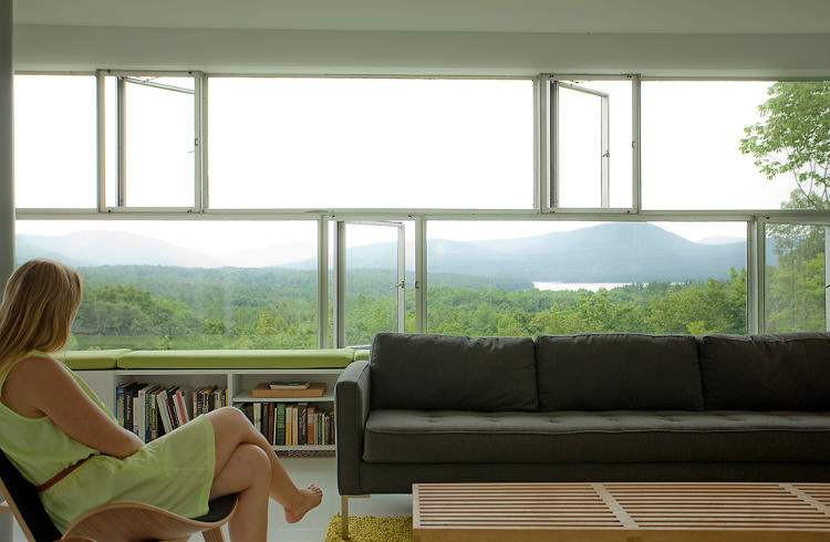 <p>The living room with panoramic views of the Catskill Mountains.</p>
