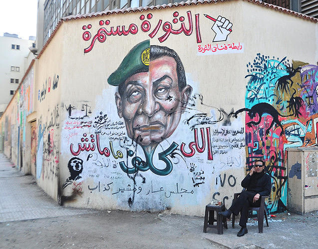 <p>&quot;The one who delegates does not die,&quot; reads this Tantawy/Mubarak art by Omar Fathy, photographed by JoAnna Pollonais.</p>