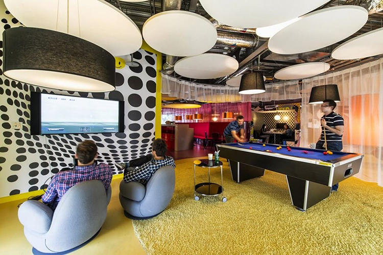 <p>Lounge chairs, pool tables, and interesting light fixtures abound, all of which help create a relaxing, fun-filled work environment.</p>