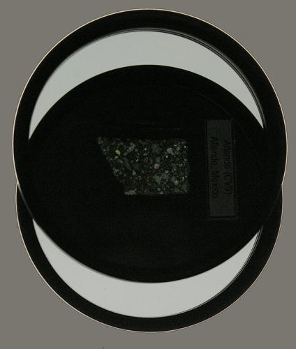 <p>Barton explains his photo setup: &quot;This is a sandwich of two polarizing filters with a thin section between them, sitting on a light table. Light is coming up from beneath (at you in this photo), passing through a polarizer, then through a paper-thin section of rock from a meteorite, then through the top polarizer and into the camera.&quot;</p>
