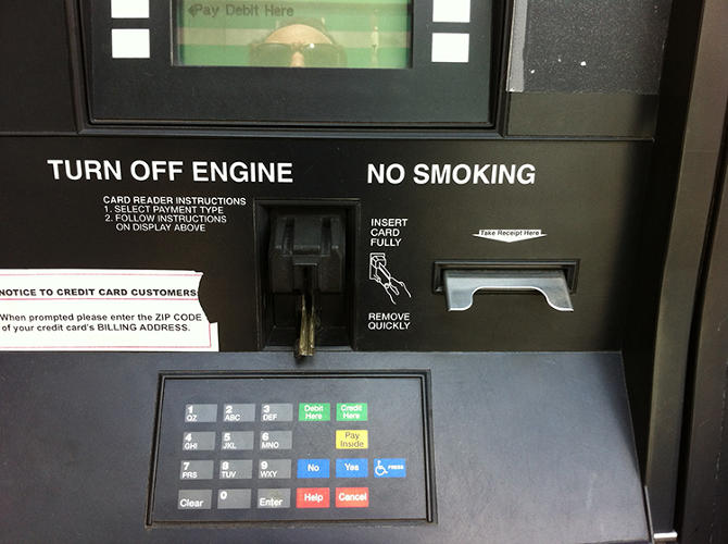 <p>In a bit of clarity, at least this graphic on a gas pump commits to the back of the credit card, the magnetic stripe indicated. (Photo by Paul Lukas)</p>