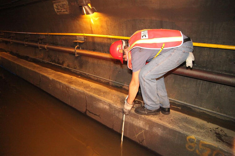 <p>Measuring the water depth in the Cranberry Street Tunnel.</p>