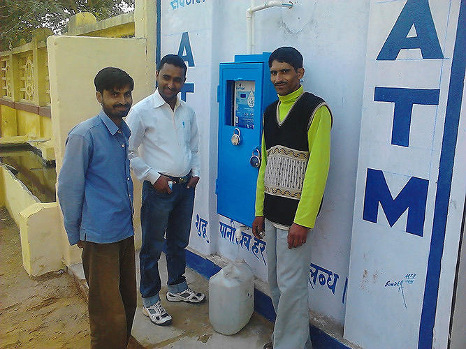 <p>Anand Shah's company Sarvajal is working to bring clean water to India. But it's not just giving it away. Instead, it's <a href=&quot;http://www.fastcoexist.com/1680830/turning-rural-indians-into-water-entrepreneurs&quot; target=&quot;_self&quot;>creating a network of water entrepreneurs, giving each a clean water franchise to run.</a> Each of these franchisees sets up &quot;water ATMs,&quot; where rural Indians can go and see their water being purified and bottled.</p>