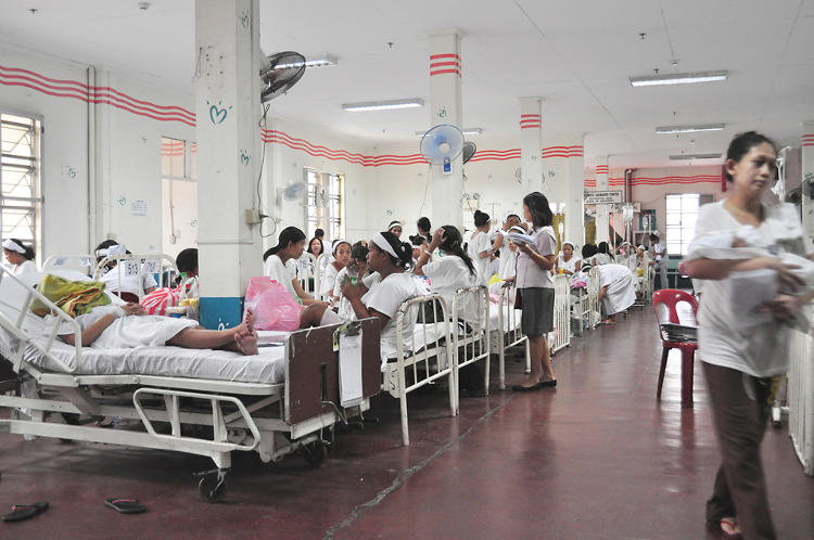 <p>Mothers try to rest at one of the many crowded maternity wards at Philippines General Hospital.</p>