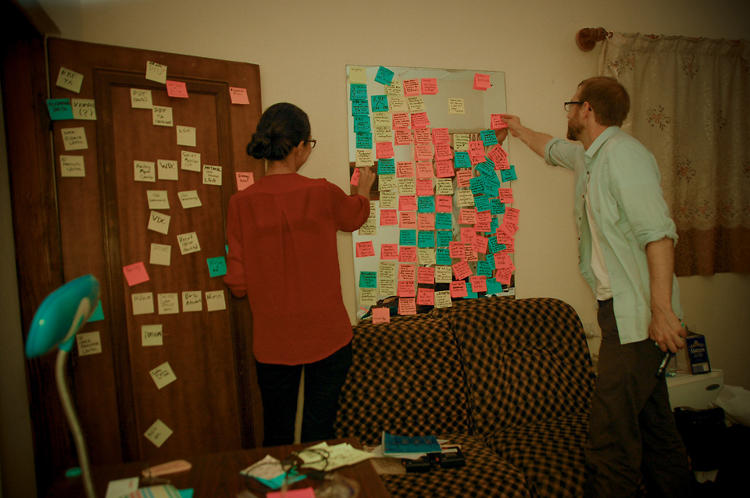 <p>After each day in the field, Reboot conducts evening synthesis. Here, at its guesthouse pop-up studio, the team determines how to adapt system functionality and program design based on that day's research and user feedback. Designers and developers then work, often late into the night, to implement changes before meeting users again the following day.</p>