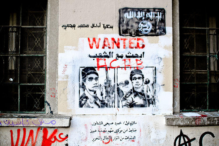 <p>&quot;Ammar Abou Bakr created a Wanted stencil and stated the name of a police officer: Mahmoud Shinawy. The officer was dubbed the 'eye sniper' became famous for shooting at protesters' eyes.&quot;</p>