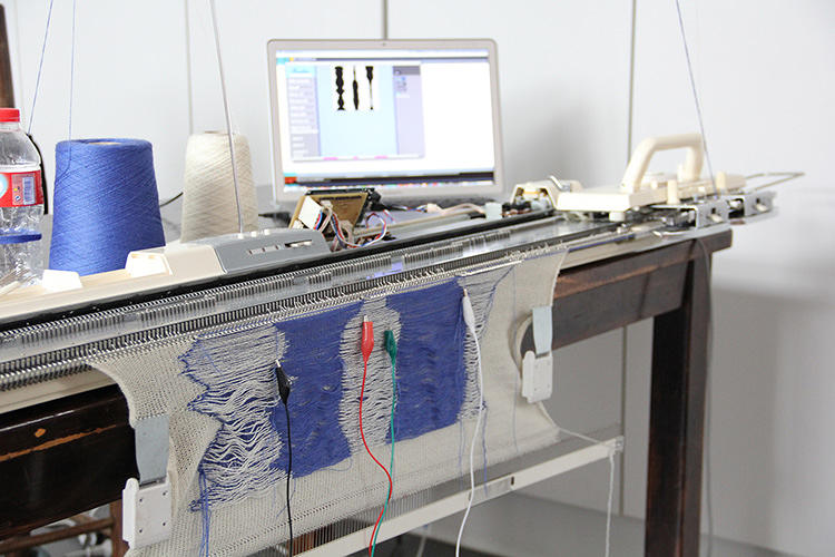 <p>Those features are then turned in a knitting pattern that's sent to a knitting machine and turned into a scarf.</p>
