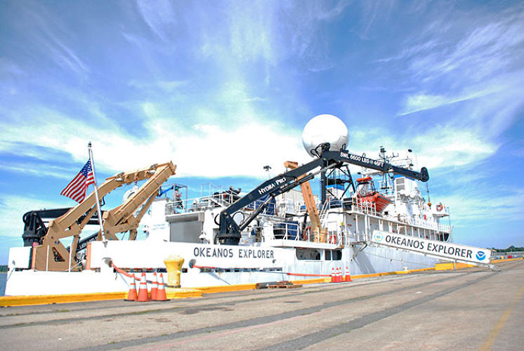 <p>The <em>Okeanos</em> is a former Navy surveillance ship about to set out on a journey into the North Atlantic, where it will use robots to scale canyons and sea mounts thousands of feet below the ocean surface.</p>