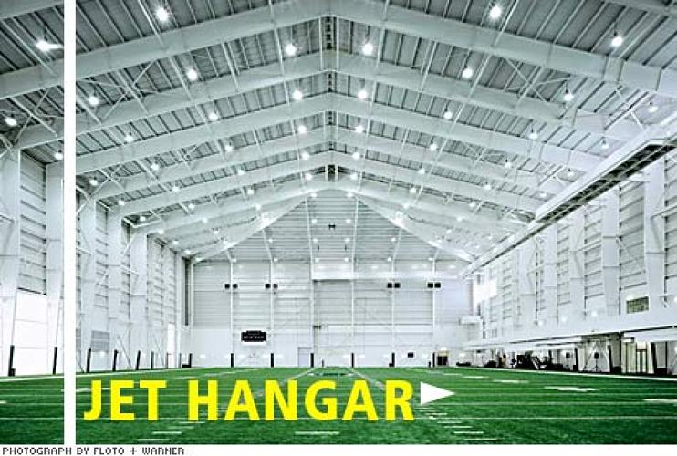 <p>A 95-foot-high bunker covers the full-size indoor practice field. <strong>The catwalk near the ceiling offers a favorable vantage point for filming</strong>; coaches can call up plays from any practice (or game) from the building's central video server.</p>