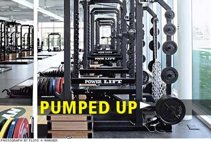 "<p>The workout area holds all the <strong>specialty weight-training equipment</strong> players could want, as well as old-school touches like a medicine-ball wall. The gym ""isn't about creating a beautiful body,"" Duffy says, but getting players into ""football shape."" Its amenities entice players to stay in New Jersey for off-season strength workouts, which coaches prefer.</p>"