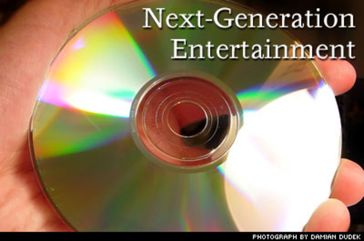 <p><strong>Phenom:</strong> DVD's replacement. <strong>What It Is:</strong> Two rival formats, HD-DVD and Blu-Ray (ah, memories of the VHS-Beta clash), compete to replace what we just got. The idea is to support high-definition TV and improve antipiracy measures. Look for first-generation stuff in late 2005. <strong>Our Take:</strong> HD-DVD is compatible with current gear; Blu-Ray isn't. But Blu-Ray has the support of the movie studios. (Sigh.) We can't believe we're going to have to buy another copy of Rudy.</p>