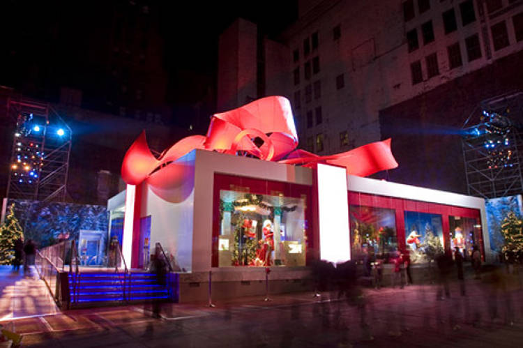 Not so much a shop but definitely an innovative holiday pop-up: Bank of America's Gift Box, which took up residence in Manhattan for 10 days during the 2007 season, offered free gift wrapping, hot chocolate, a childrens'  play area, and public restrooms--all to publicize the premiere of the BankAmericard.