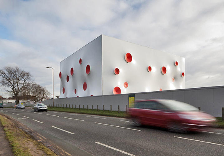 Either the place was blasted by the world's silliest M60 or a giant octopus has invaded London. </br></br> <a href=&quot;http://www.fastcodesign.com/1669263/olympics-shooting-gallery-looks-like-a-giant-octopus#1&quot;>Read more here</a>