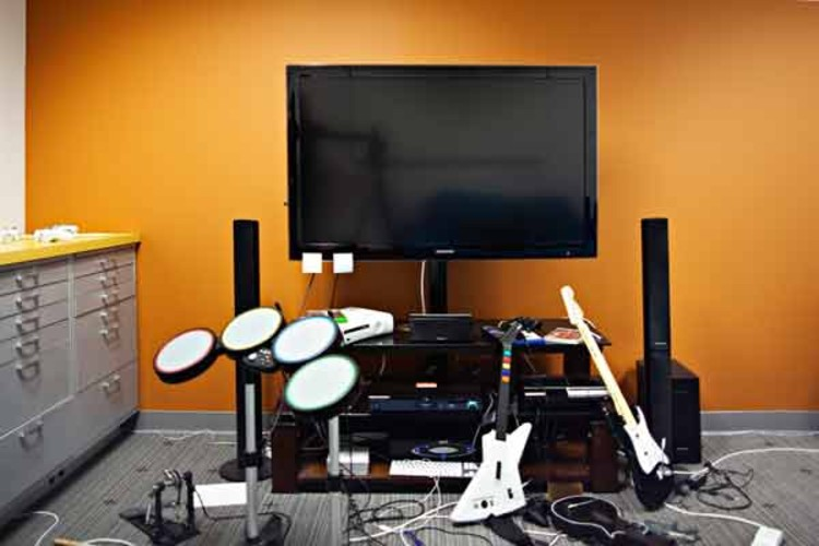 Employees keep long hours, and often let off steam together.  More than one meeting room has game or musical equipment, though this one is reputed to be the location of more than one ill-advised performance video.