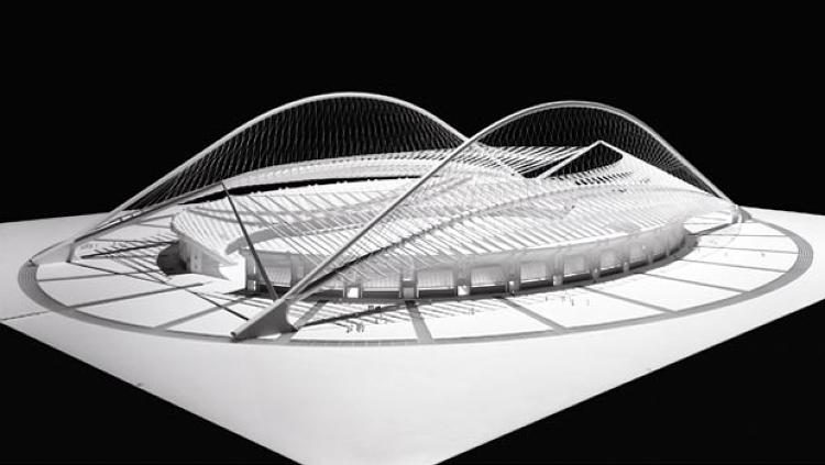 The roof of Calatrava's Olympic Stadium for the Summer 2004 games in Athens, resembles two bent leaves, made of tubular steel. Given the difficulties in constructing these while work was going on with other buildings, Calatrava arranged to have them prefabricated in another location. The arches over the roof mirror many of Calatrava's sketches of bodies in motion, a particularly apt metaphor for an athletic venue.<br /><br /> <a href=&quot;http://www.fastcompany.com/magazine/142/calatrava-goes-public.html&quot; target=&quot;_blank&quot;><strong>Read more about Santiago Calatrava</strong></a>