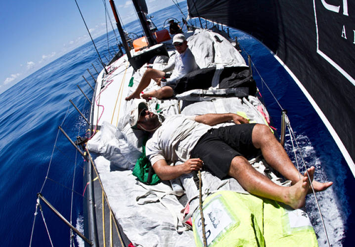 Taking a break in the mid day heat onboard Abu Dhabi Ocean Racing during leg 6 of the Volvo Ocean Race 2011-12, from Itajai, Brazil, to Miami, USA.