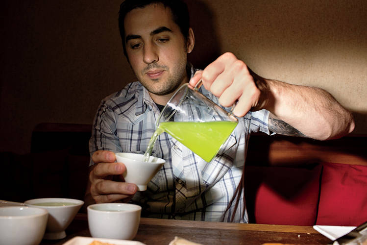 <p><strong>2:42 P.M.</strong><br /> At Samovar Tea Lounge, Rose pours a cup of green tea ecstasy, one of his favorites.</p>