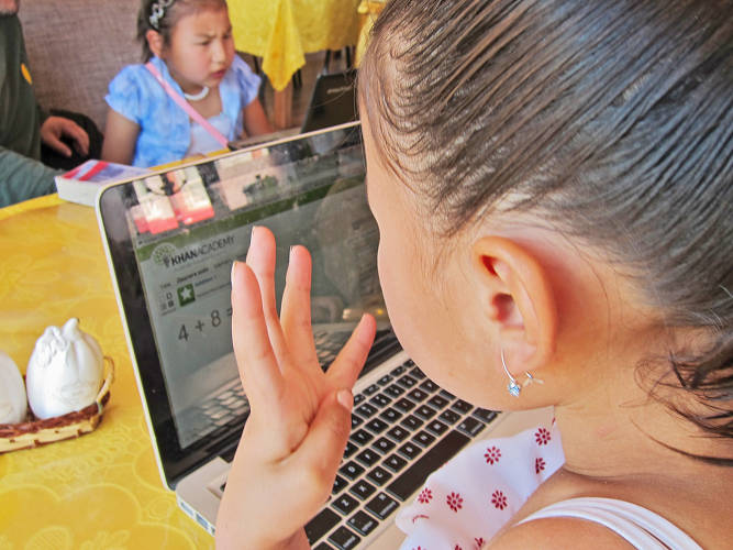 <p>8yr old children in Mongolia practicing on Khan Academy</p>