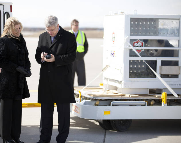 <p>Canadian Prime Minister Stephen Harper signs for the packages with Lisa Lisson, president of FedEx Express Canada. (Psst, PM, there's a bear behind you!)</p>