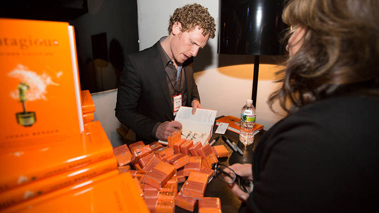 <p>Jonah Berger signs copies of his book, <em><a href=&quot;http://www.amazon.com/Contagious-Why-Things-Catch-On/dp/1451686579&quot; target=&quot;_blank&quot;>Contagious</a></em>, for event attendees.</p>