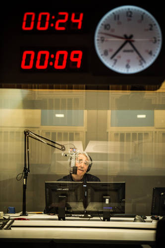 <p>The first broadcast from 1111 N. Capitol. Host Scott Simon readies Weekend Edition in Studio 31.</p>