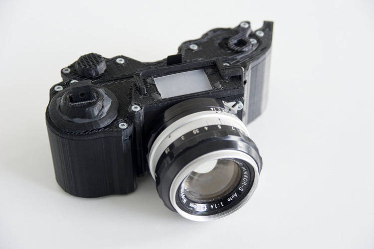 <p>Made out of $30 in scrap parts and lots of printed plastic, Leo Marius' 3-D printed SLR camera takes great photos and even has a custom lens mount to keep the camera modular.</p>
