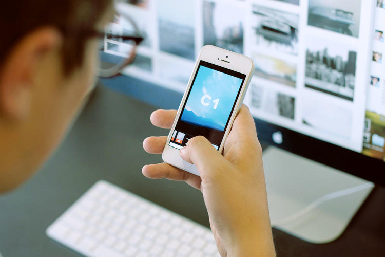 <p>A user thumbs through the iOS app. (Photo by Jerad Knudson)</p>