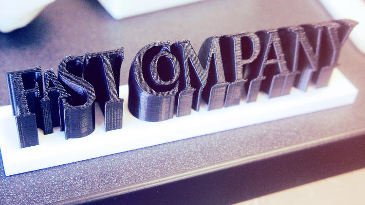 <p>Detail shot of the The UPS Store printed <em>Fast Company</em> logo</p>