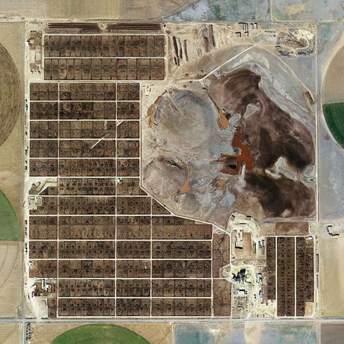 "<p>""We have factory farming in England, but we don't have it on that scale. I was just absolutely blown away,&quot; Henner says.</p>  <p>Randall County Feedyard, Amarillo, Texas (2013)</p>"