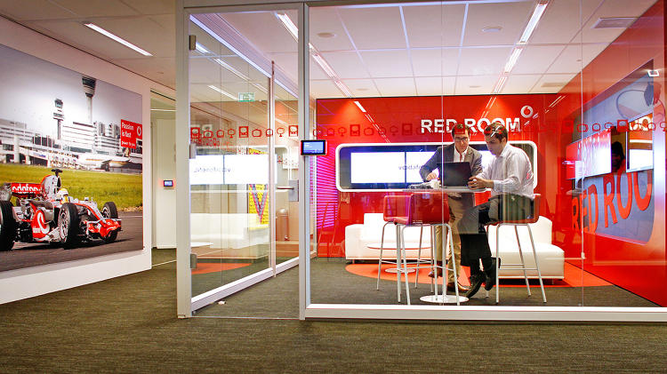 <p>At Vodafone in Amsterdam, workers can quickly move into small rooms such as this one for solo, focused work or small group collaboration at Vodafone.</p>