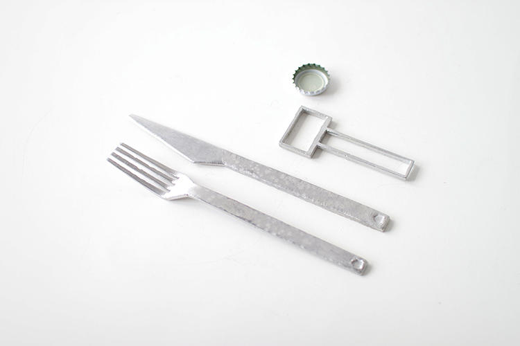 <p>The silverware was made from melted pewter shaped in an old cereal box.</p>