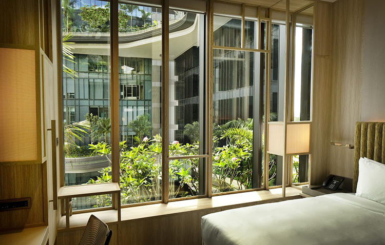 <p>Above, hotel rooms have a view of the suspended gardens, which help filter incoming daylight.</p>