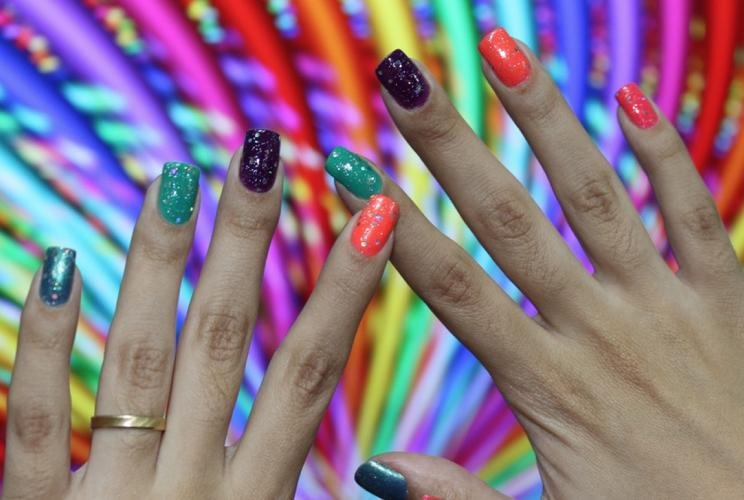 <p>Shiny, colorful, highly-laquered and stylish--plus often featured in <a href=&quot;http://populagram.appspot.com/tag/NAILS&quot; target=&quot;_blank&quot;>Instagram photography?</a> Yes. It's not an iPhone 5C, unless you have ten of 'em glued to your fingertips.</p>  <p>Flickr user <a href=&quot;http://www.flickr.com/photos/leleuzis/5499724864/&quot; target=&quot;_blank&quot;>Lelê Breveglieri</a></p>