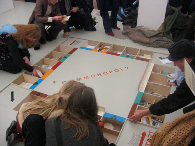<p>Miklos Erhardt, Dominic Hislop, and Elske Rosenfeld redesigned the game so that no one player was the banker, and that all had to collaborate on their moves.</p>