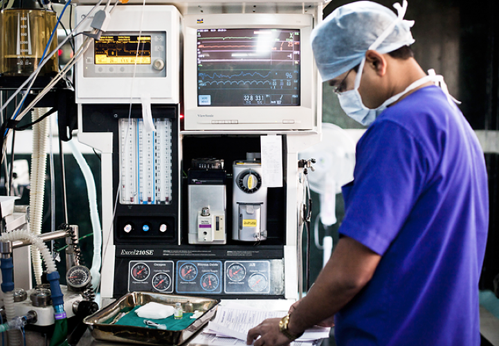 <p>A anesthetist seen next to the machines manning the patient during an open heart surgery at operation theatre of the Narayana Hrudayalaya in Bangalore, Karnataka, India.</p>