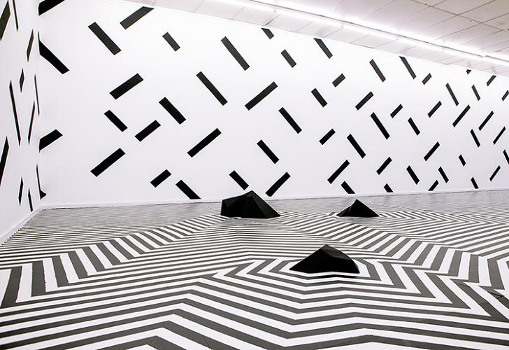 <p>The pool has been dropped, and the floor embellished with a rhythmic, monochromatic pattern Songailo says bears the influence of Op-artist Bridget Riley.</p>