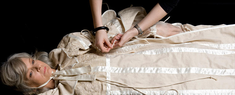 <p>A Garment for the Grave is laid into a casket before the corpse, then tied around them later.</p>