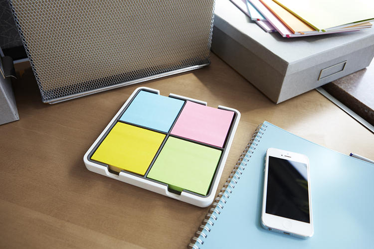 <p>Post-it's notes in electric blue, electric yellow, neon pink, and limeade are automatically recognized and categorized by the Evernote app. The dispenser pictured can hold four packs of notes.</p>