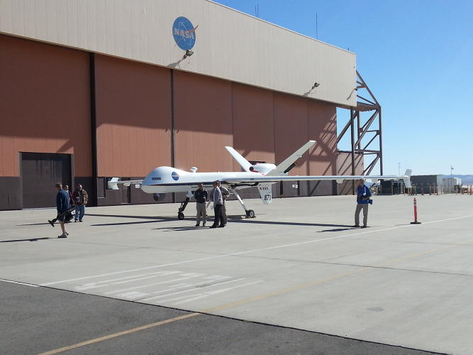 <p>The Ikhana drone on the ground near the mobile control center used for the UAV on remote missions at Edwards Air Force Base.</p>