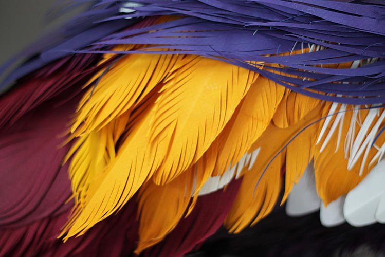 <p>A close-up of Herrera's cut paper feathers.</p>