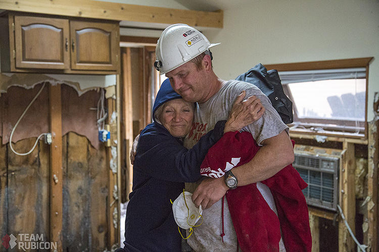 "<p>""I cried just about every time I hugged one of the volunteers (they were always covered in muck),"" homeowner Donna Waida wrote of Team Rubicon, the disaster relief organization that sent the veterans to her waterlogged home.</p>"