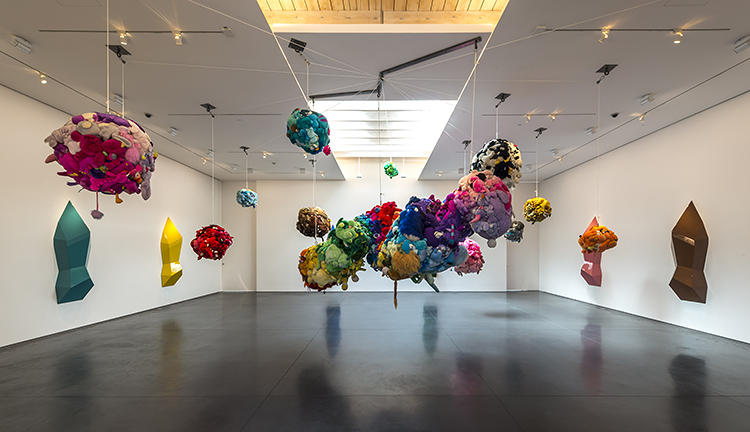 <p><em>Deodorized Central Mass With Satellites</em> took Kelley a decade to create. These 12 clusters of stitched-together stuffed animals are suspended from the ceiling in a pulley system and surrounded by geometrical resin sculptures affixed with air fresheners, which spritz Pine-Sol at timed intervals.</p>