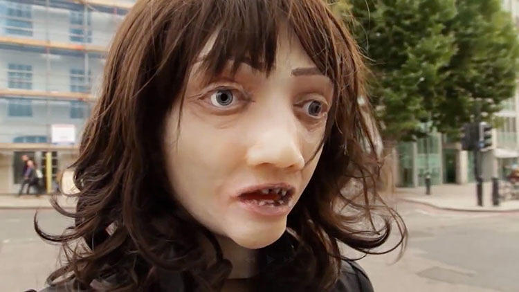 <p>Rubber masks with rotten yellow teeth, a hole in the trachea, and gangrenous skin: What looks like a publicity stunt for <em>The Walking Dead</em> is actually an anti-smoking campaign created just in time for Halloween.</p>