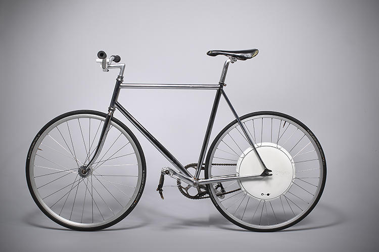 <p>A few years ago, a shiny red wheel that turns any bike into an electric bike emerged from MIT's SENSEable Lab, promising a future of lazy two-wheeled transportation for all. But despite numerous promises, the Copenhagen Wheel has yet to hit the market.</p>