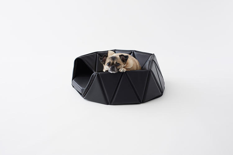 <p>Part of a three-piece set of accessories called &quot;Heads or Tails,&quot; the bed is made of triangular panels of artificial leather, connected in polygon mesh.</p>
