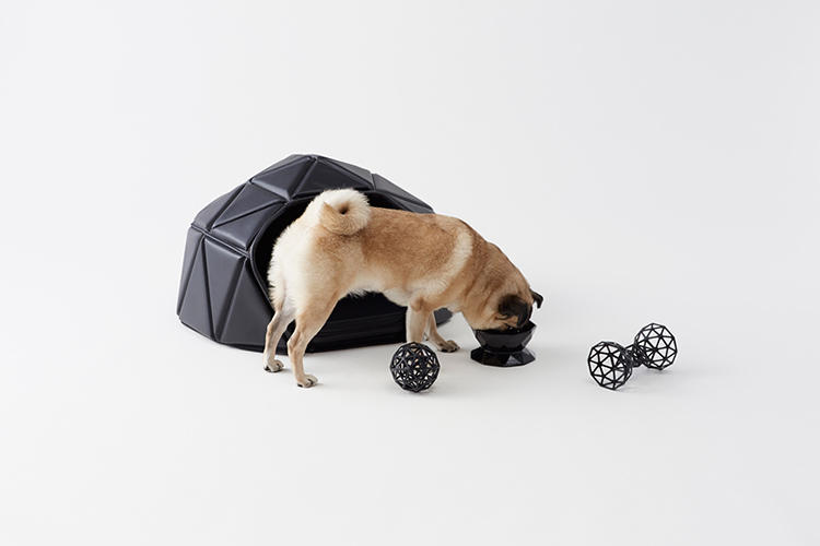 <p>In Toto black or Dogbert white, it become an igloo-like hut when a dog burrows inside, then collapse into a bed when it climbs on top.</p>