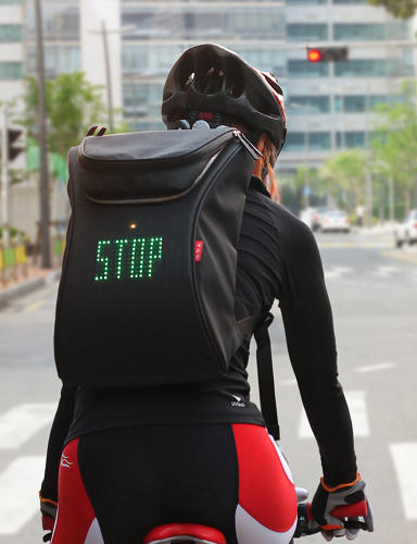 <p>That's not enough, says Korean designer Lee Myungsu, the creator of the SEIL bag, which effectively turns a cyclist's backpack into moving traffic lights and indicators.</p>