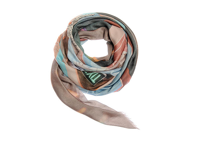 <p>Part of what makes these pieces so unique is that they don't feature repeating patterns or motifs, like many textiles. Instead, each scarf is printed with one large, single image, which folds into an abstract jumble of colors when worn.</p>