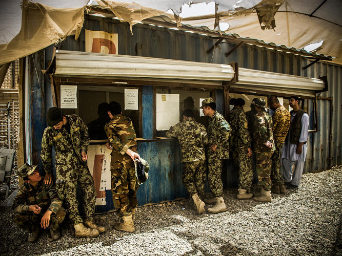 <p>Soldiers of the Afghan National Army's 1/215 brigade collect their pay at an on-base bank.</p>